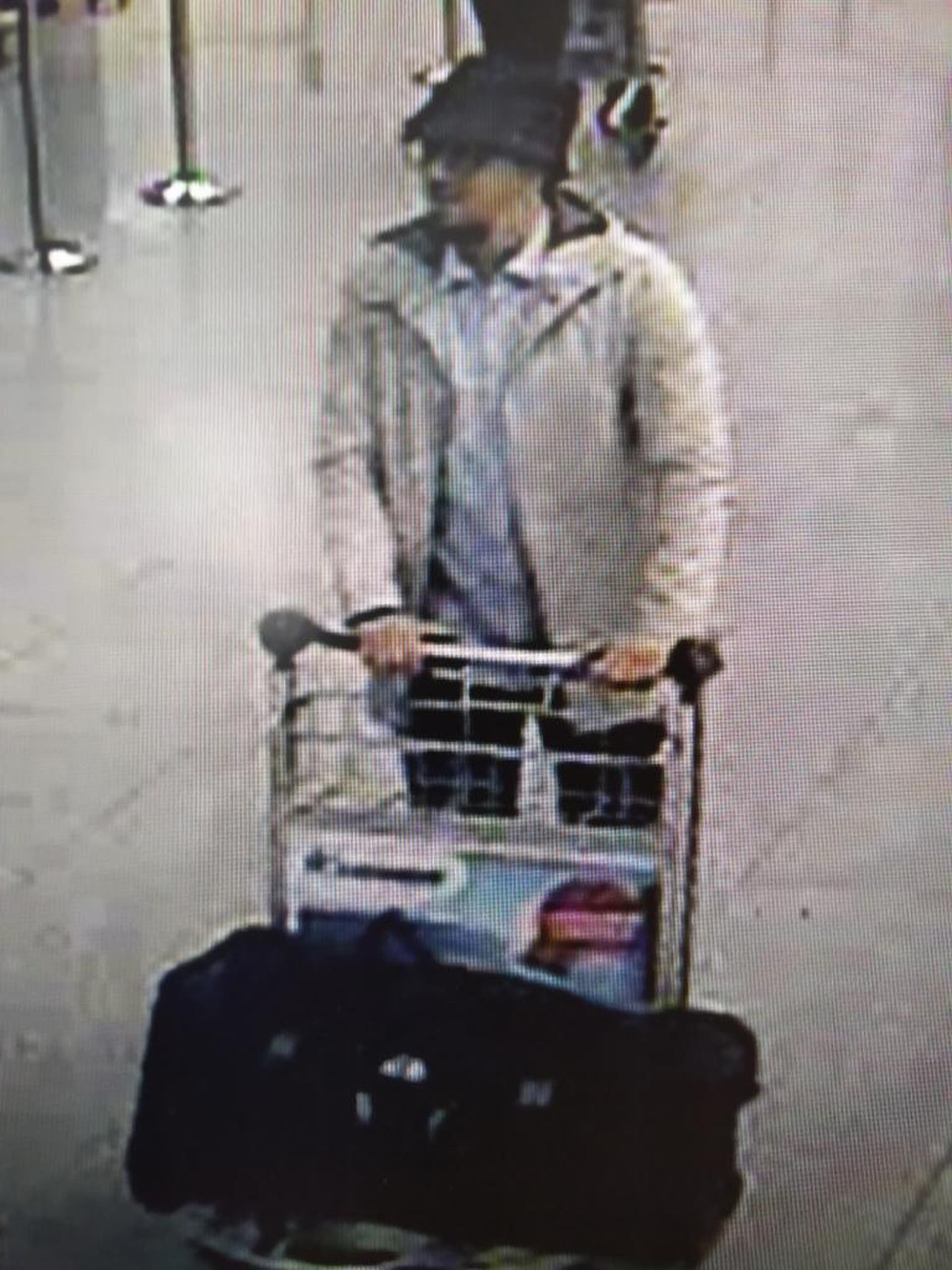 Police issued a wanted notice for a man suspected of involvement in Tuesday's bomb attacks at Brussels airport. (AP)