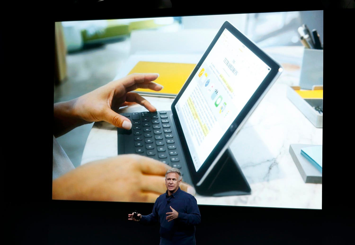Phil Schiller, senior VP of worldwide marketing for Apple, introduces the iPad Pro with 9.7-inch display during an event at the Apple headquarters in Cupertino, California. (Reuters)