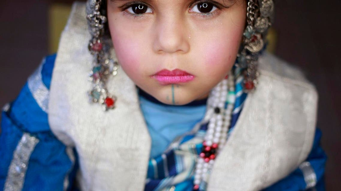 A girl wearing traditional costume poses for a picture during Children's Day celebrations, at a school in Benghazi, Libya March 21, 2016. (Photo: Reuters)