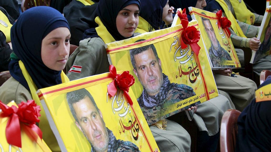 Lebanon's Hezbollah al-Mahdi girl scouts carry pictures of Ali Fayyad, one of Hezbollah's senior commanders who was killed fighting alongside Syrian army forces in Syria. (File photo: Reuters)