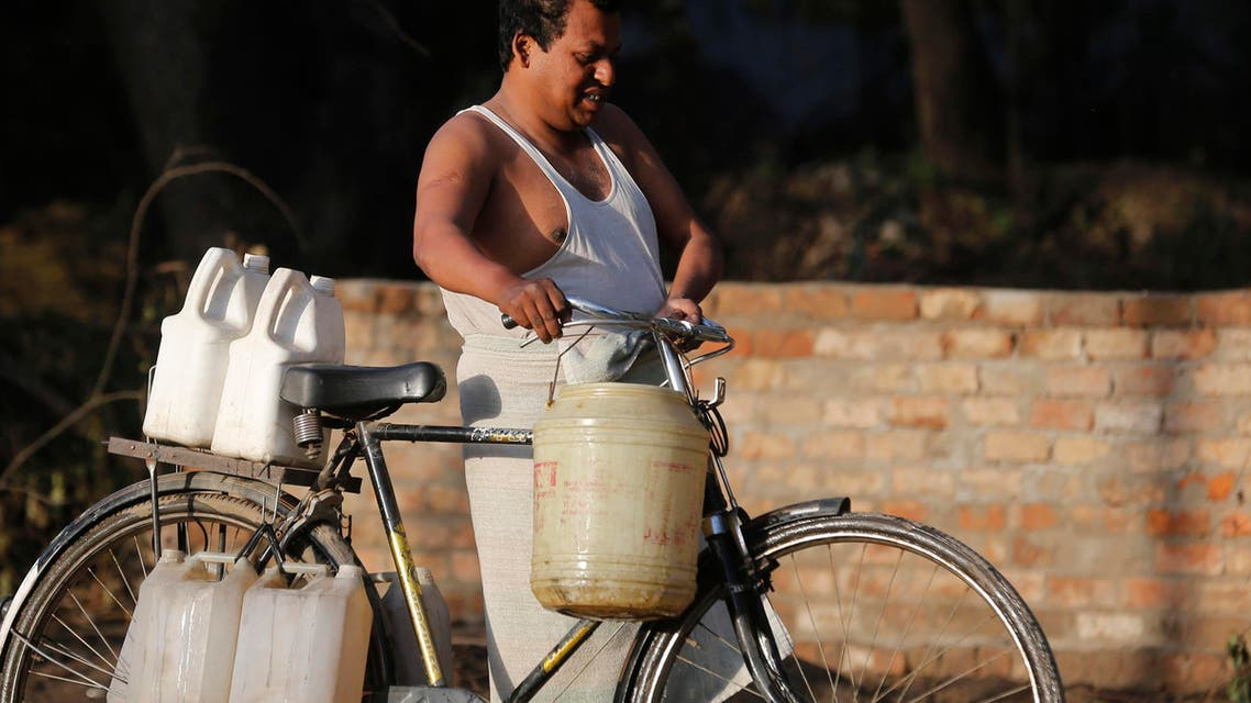 An Indian man pushes a bike loaded with containers filled with drinking water in Allahabad, India, Tuesday, March 22, 2016. (AP)