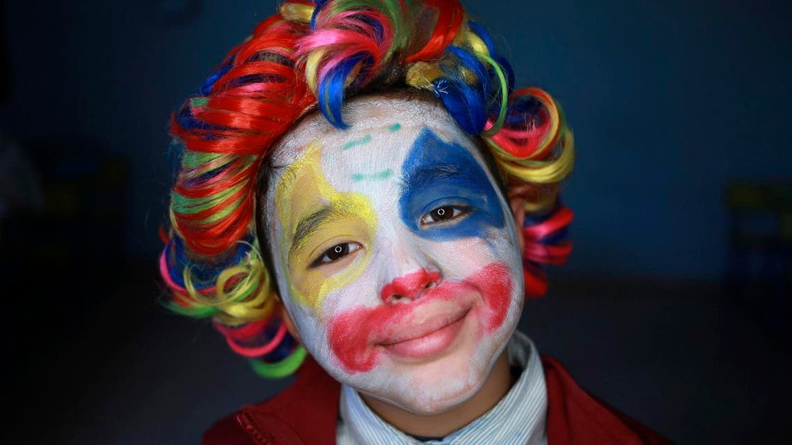 A boy with clown make up poses for a picture during Children's Day celebrations, at a school in Benghazi, Libya March 21, 2016. (Photo: Reuters)