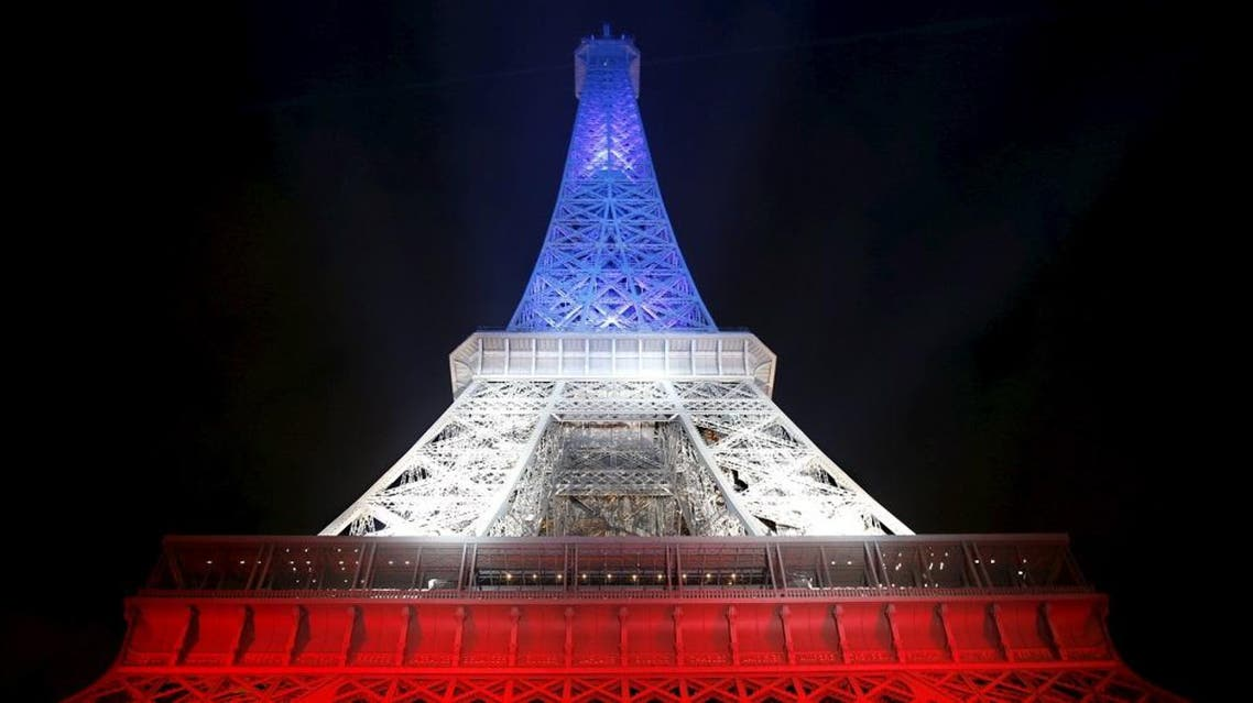 The Eiffel Tower is lit with the blue, white and red colours of the French flag in Paris, France, November 22, 2015 (Reuters)