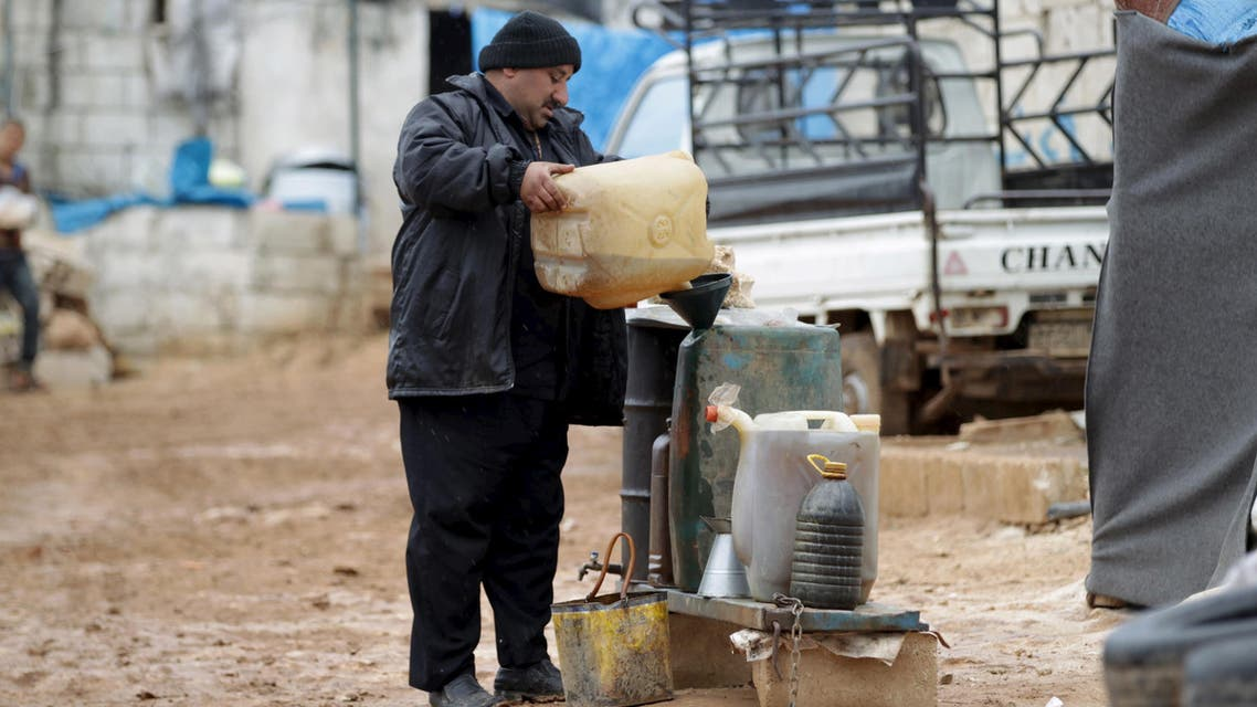 A vendor sells fuel outside tents housing internally displaced people in Atma camp, near the Syrian-Turkish border in Idlib Governorate, Syria March 15, 2016. (Reuters)