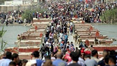 العراق.. 6515 أسرة عائدة و2435 أسرة نازحة في الأنبار