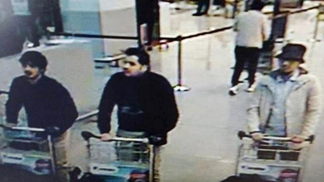 Najim Laachraoui, seen in a white coat and black hat shortly before the attack in photos released, was identified as the third suspect. (Reuters)