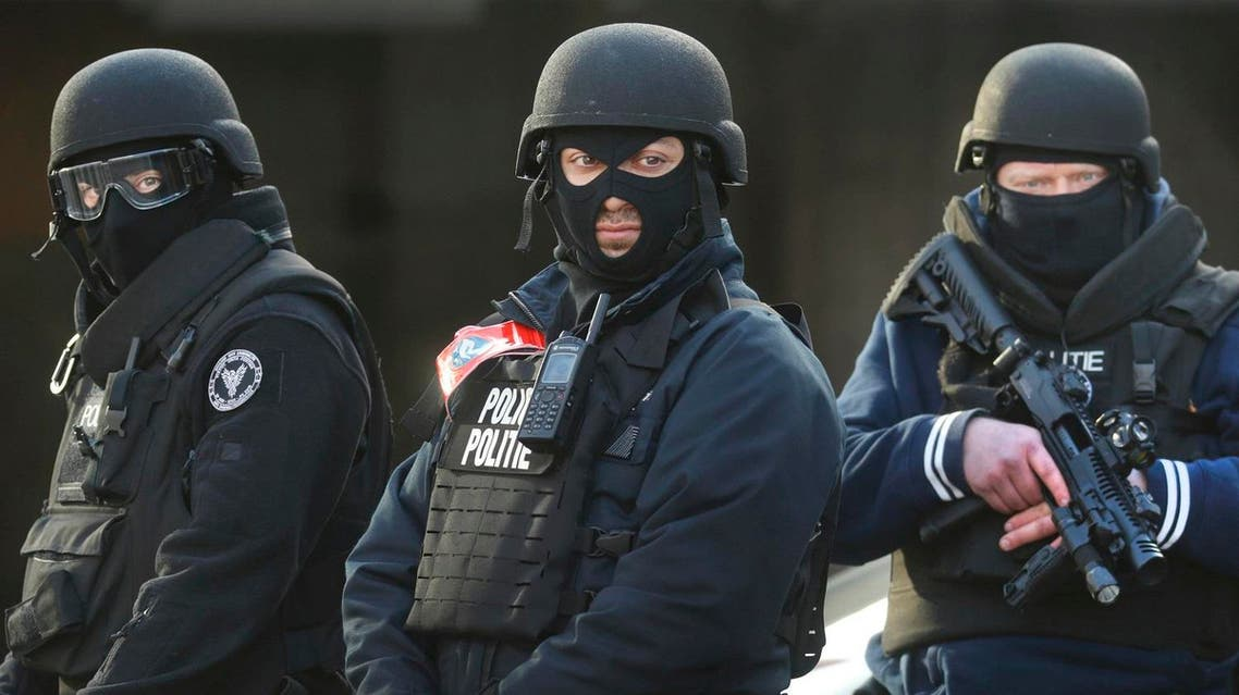 Police stand guard at Midi train station following bomb attacks in Brussels, Belgium. (Reuters)