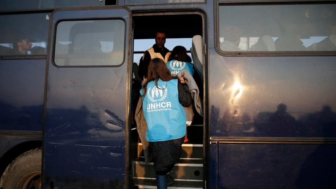 UNHCR volunteers step on a Greek Coast Guard bus to check on refugees and migrants rescued at open sea and waiting to be transferred to the Moria registration centre at the port of Mytilene on the Lesbos, Greece March 21, 2016. Picture taken March 21 (Reuters)