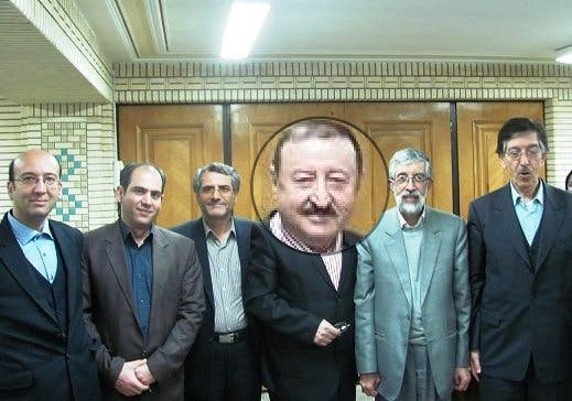 صفر عبدالله الى جانب غلام علي حداد عادل رئيس مجمع اللغة الفارسية