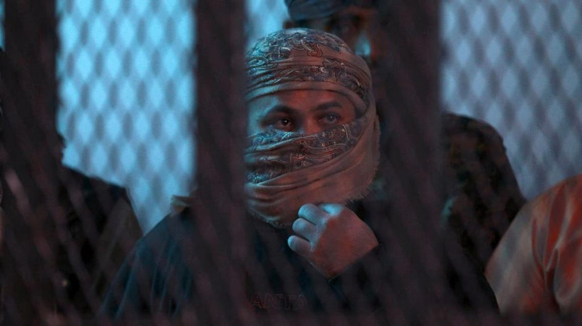 Suspected Al-Qaeda militants stand behind bars during a hearing at the appeals court in the Yemeni capital Sanaa. (AFP)