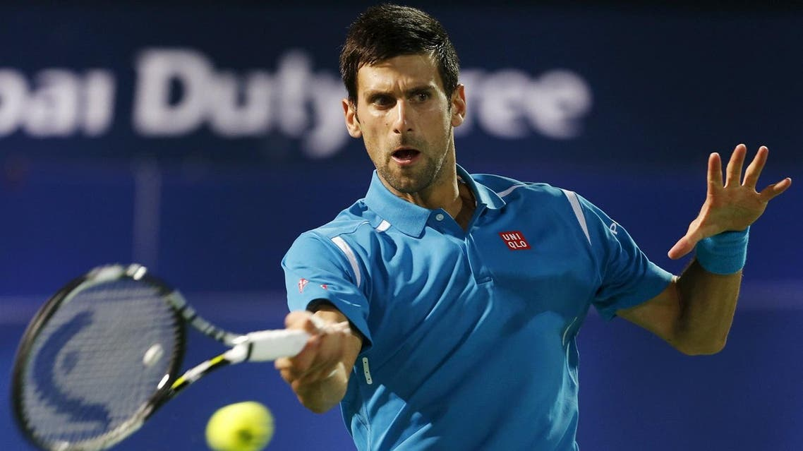Novak Djokovic of Serbia returns the ball to Feliciano Lopez of Spain during their match at the ATP Dubai Duty Free Tennis Championships. (Reuters)
