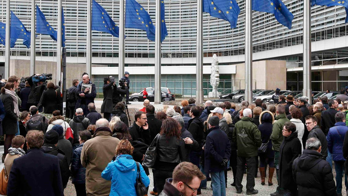 People observe a minute of silence outside the EU Commission Headquarters in Brussels following Tuesday's bomb attacks in Brussels, Belgium, March 23, 2016. (Reuters)
