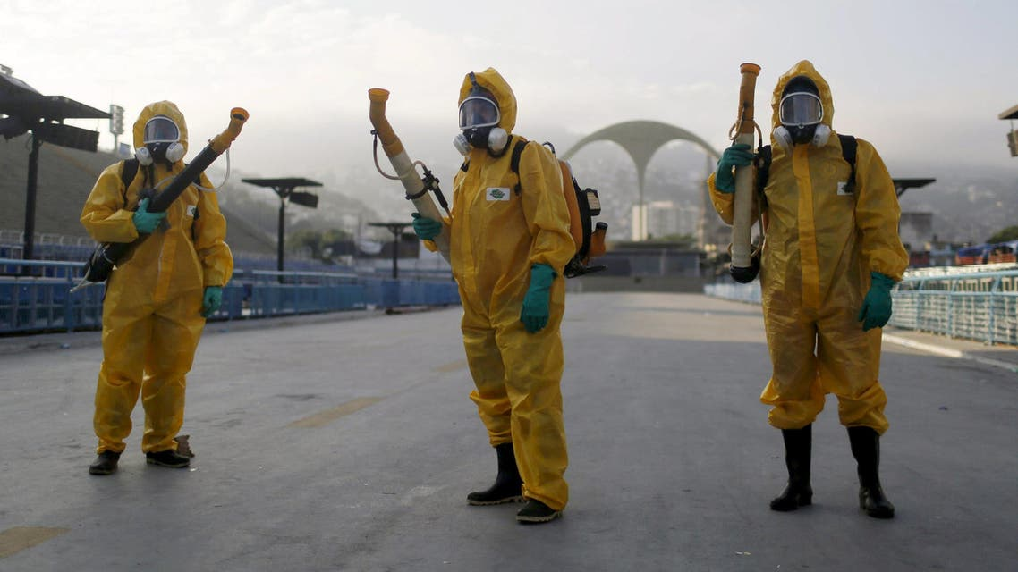 Municipal workers wait before spraying insecticide at Sambodrome in Rio de Janeiro, Brazil, in this January 26, 2016 file photo. (Reuters)
