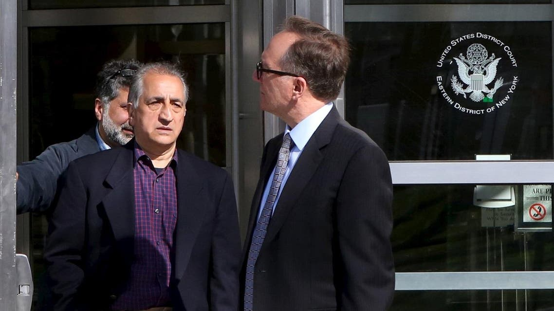 Ahmad Sheikhzadeh (C), a consultant to the Iranian mission to the United Nation, leaves Brooklyn Federal Court in New York, March 23, 2016. Sheikhzadeh, 60, is accused of charges related to sanctions violations, money laundering and tax matters, his lawyer Steve Zissou said at the hearing. REUTERS