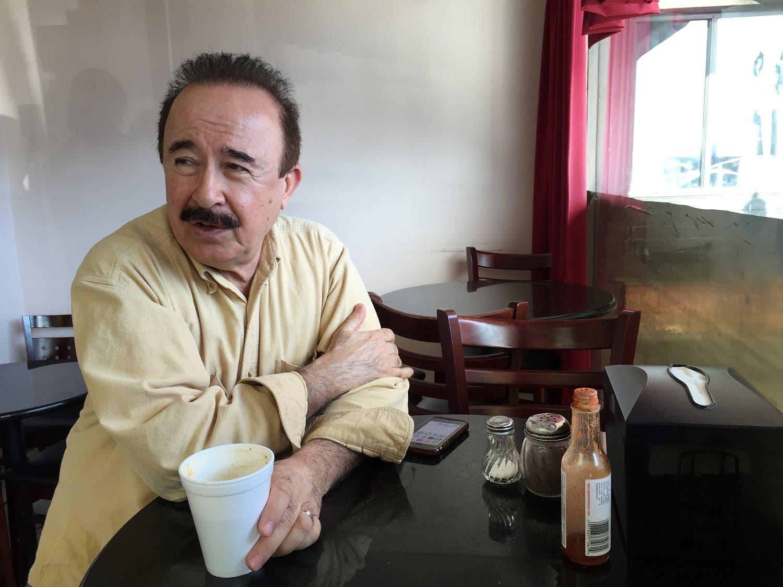 Ahmad Tarek Rashid Alam, publisher of the Arabic-language weekly community newspaper The Arab World, drinks tea at Forn Al Hara restaurant in Orange County's Little Arabia in Anaheim, Calif., on Tuesday, March 22, 2016. (AP)