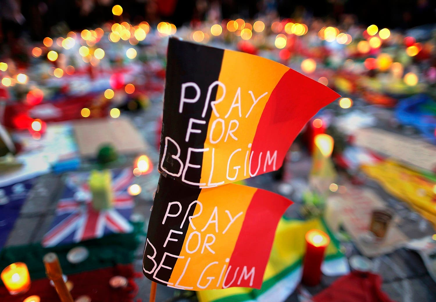 Belgian flags seen at a street memorial service near the old stock exchange in Brussels following Tuesday's bomb attacks in Brussels, Belgium, March 23, 2016. (Reuters)
