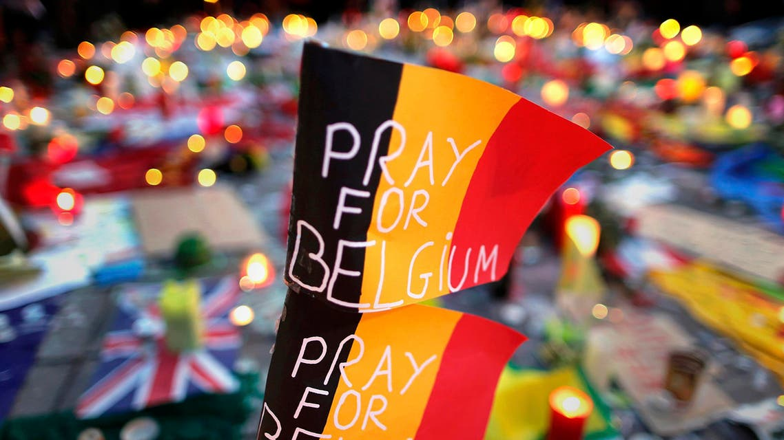Belgian flags seen at a street memorial service in Brussels following bomb attacks in Brussels, Belgium. (Reuters)