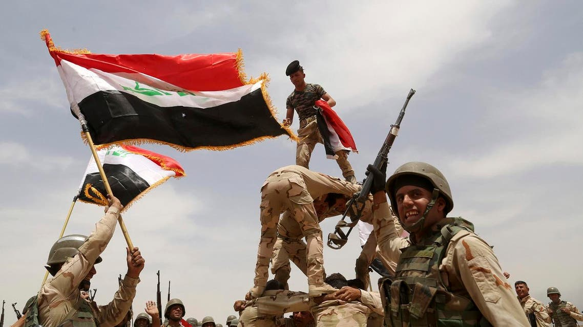 Iraqi army soldiers celebrate during a training mission outside Baghdad, Iraq. (File photo: AP)