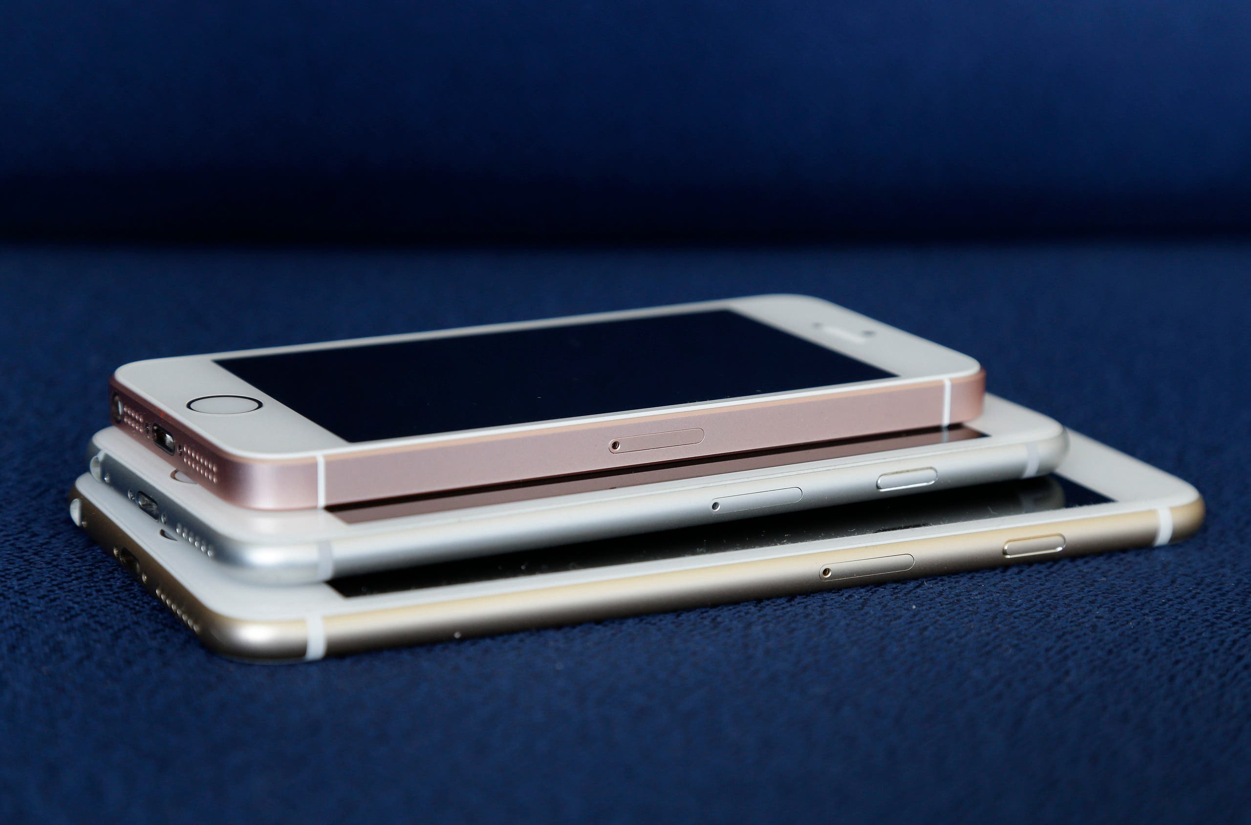 From bottom, the iPhone 6S Plus, 6S and SE lie stacked on one another. (AP)