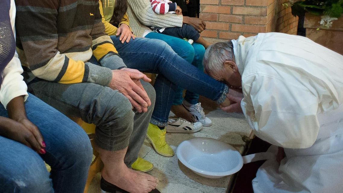 Pope Francis, right, kisses the foot of a woman at Rebibbia prison in Rome, Thursday, April 2, 2015.  (AP)