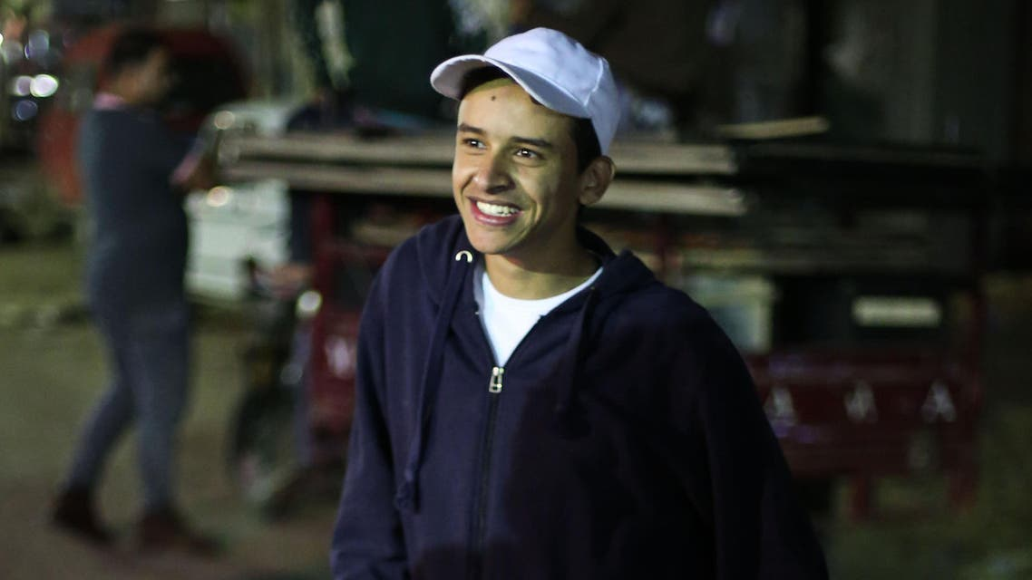 In this Thursday, March 24, 2016 photo, Egyptian activist Mahmoud Mohammed Ahmed smiles after his release from a police station in Cairo, Egypt. An Egyptian court on Thursday, March 24, 2016 ordered the release of Ahmed, who was accused by police of taking part in unauthorized demonstrations, possession of explosives and paying money to others to take part in street protests, his brother and lawyer told The Associated Press. He was never formally charged during his two years in detention. (AP Photo/Mohamed el Raai)