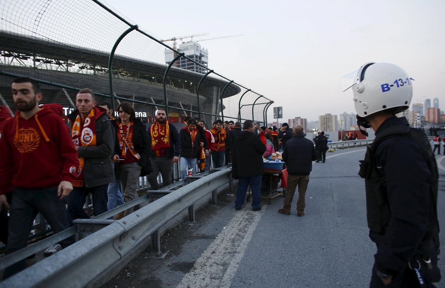 A riot police officer stands guard as Galatasaray soccer fans leave from the Turk Telekom Arena in Istanbul. (Reuters)
