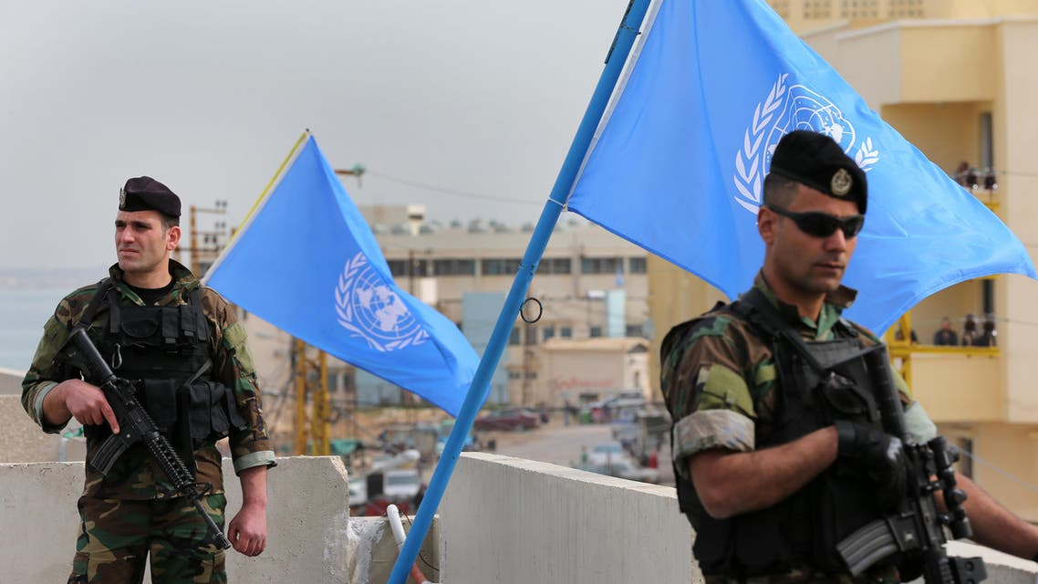 Lebanese army soldiers stand guard on the rooftop of a school building where the United Nations secretary-general Ban Ki-moon visit it, in the Palestinian refugee camp of Nahr el-Bared near the northern city of Tripoli, Lebanon, Friday, March 25, 2016. Ban appealed Friday from Lebanon, urging the international community to provide necessary funding to help finish the rebuilding of a Palestinian refugee camp destroyed in fierce battles against al-Qaida-inspired militants almost a decade ago. (AP Photo/Hussein Malla)