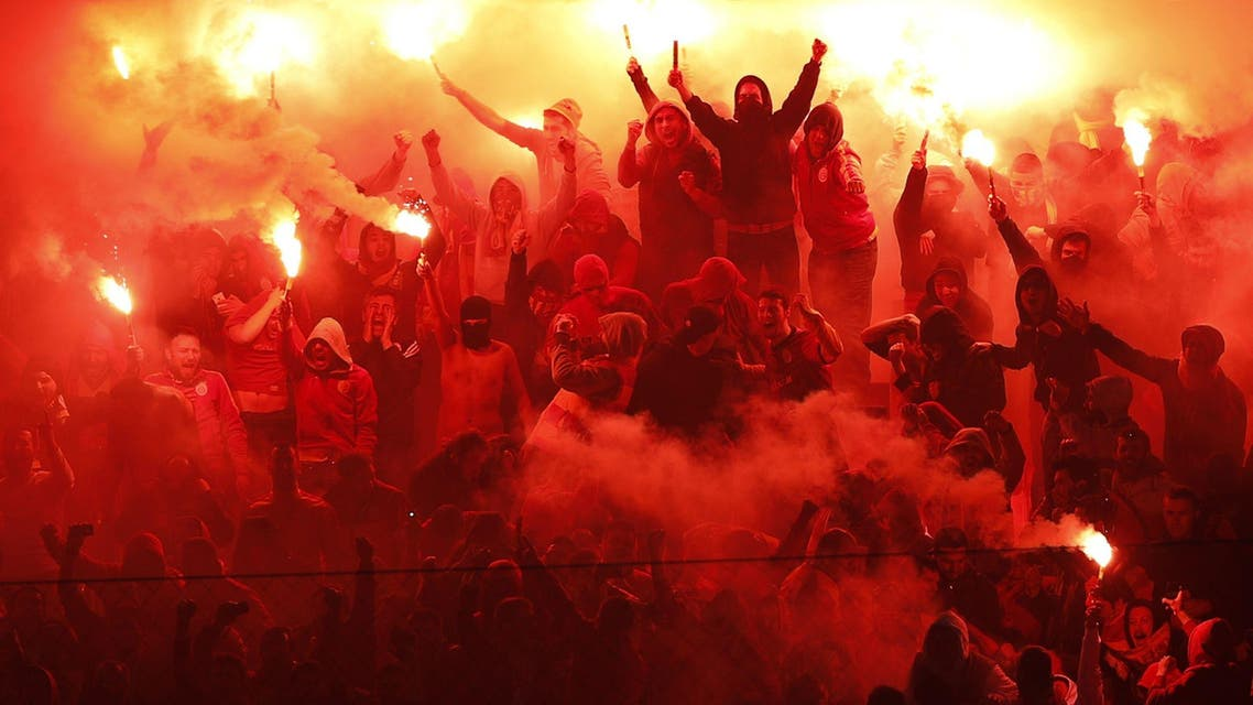 Galatasaray fans light flares to celebrate their goal against Fenerbahce during the Turkish Super League derby soccer match between Galatasaray and Fenerbahce in Istanbul April 6, 2014. (Reuters)