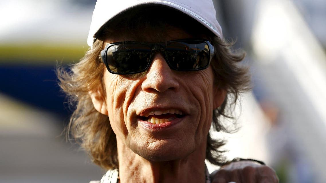 Mick Jagger of the Rolling Stones talks to the media after landing in Havana, March 24, 2016. (Reuters)