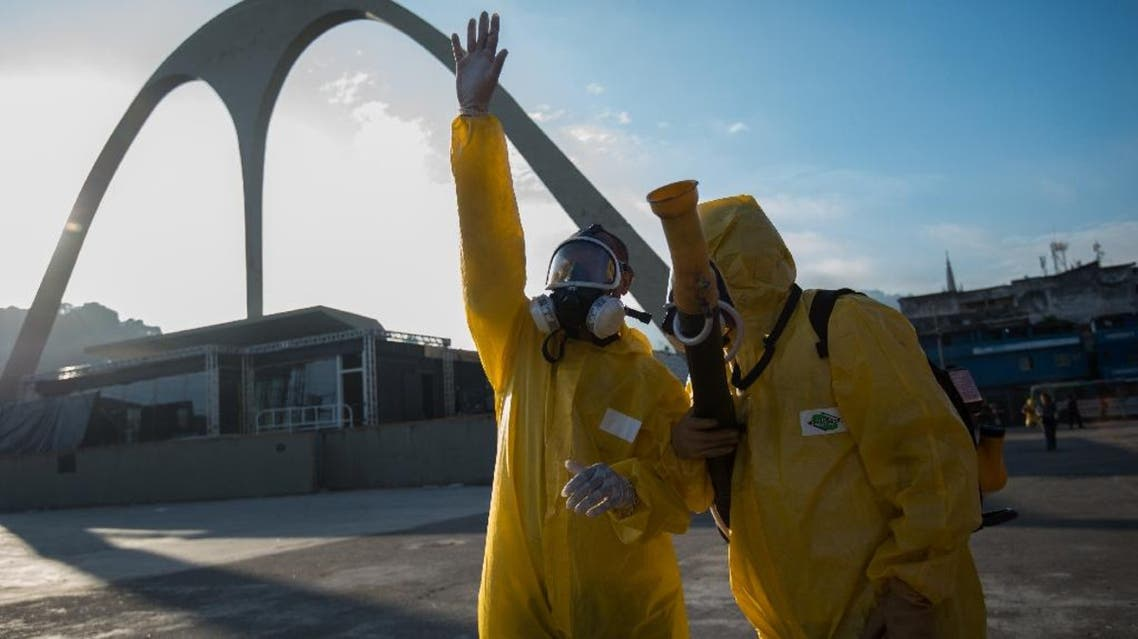Municipal agents prepare to spray anti-Zika mosquitos chemical product at the sambadrome in Rio de Janeiro. (AFP)