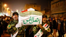Iraqi fighters in Syria boon to Assad, bane to Abadi's authority