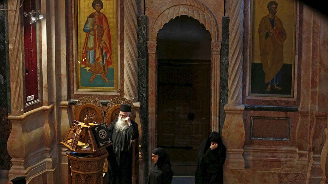 Greek Christian clergy pray on Good Friday, before a procession in the Church of the Holy Sepulchre in Jerusalem's Old City March 25, 2016. reuters