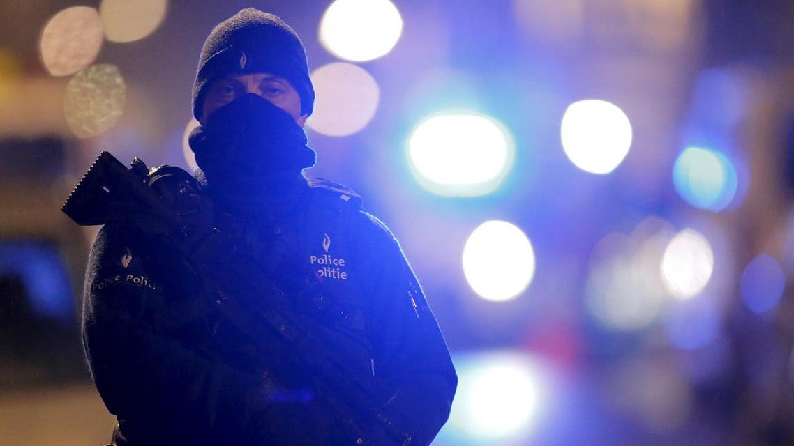 A masked Belgian police officer takes part in police operations in Schaerbeek. (Reuters)