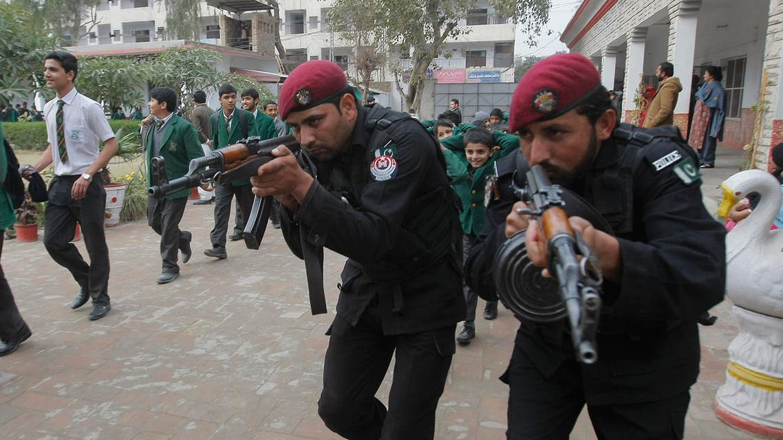Pakistani police commandos take part in a security drill at a local school in Peshawar, Pakistan, Thursday, Jan. 28, 2016. Pakistani authorities closed all the schools in the country's largest province, Punjab, following an alert over possible militant attacks, according to a government notice. (AP Photo/Mohammad Sajjad)