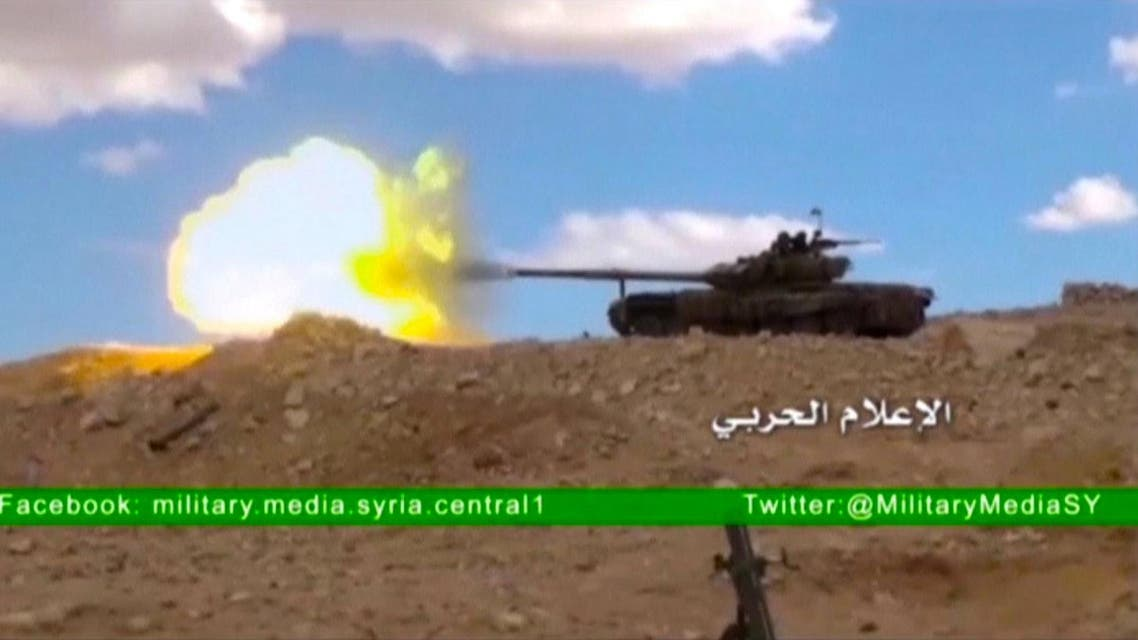 A tank fires at where the Syrian military media said is Palmyra, in this still image taken from a Syrian military media video uploaded on March 23, 2016. (Reuters)