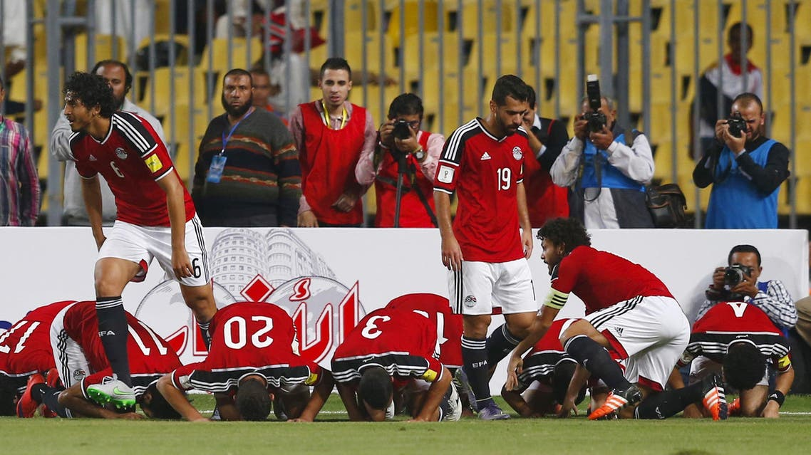 """Egypt's players pray as they celebrate after Ahmed Hassan """"Koka"""" scored a goal during their 2018 World Cup qualifying soccer match against Chad at Borg El Arab """"Army Stadium"""" in the Mediterranean city of Alexandria, north of Cairo, Egypt, November 17, 2015. (Reuters)"""