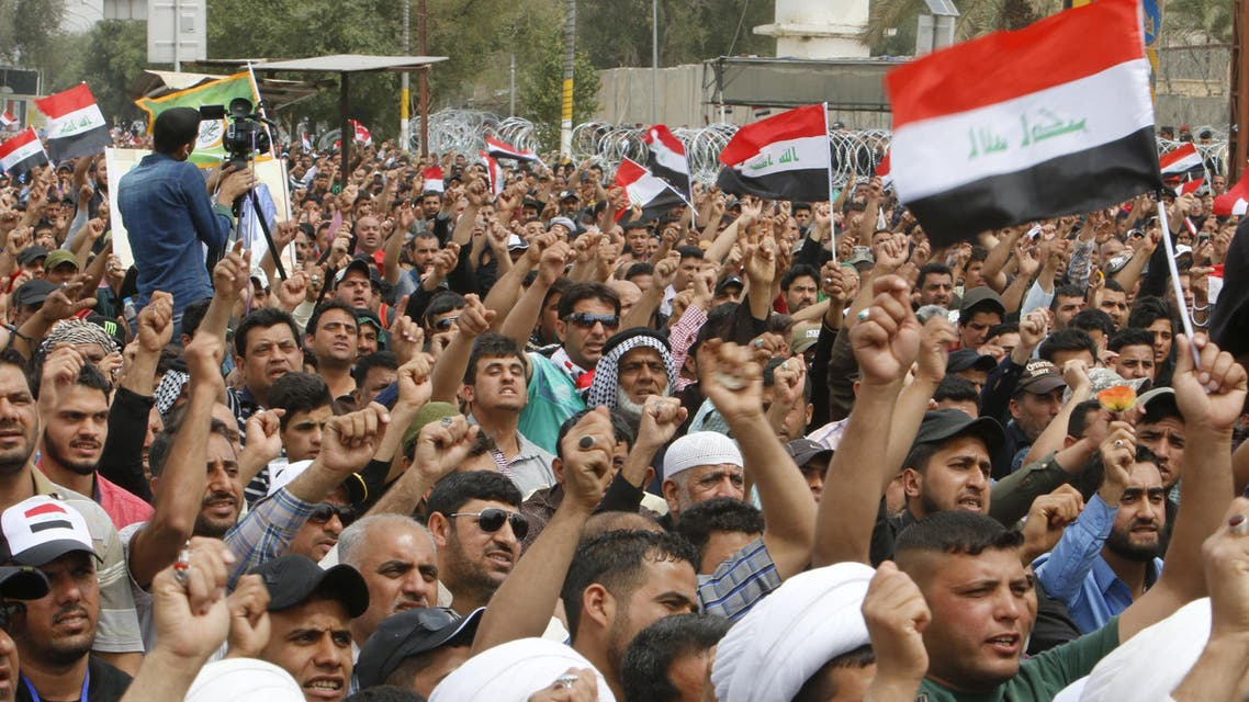 Supporters of prominent Iraqi Shi'ite cleric Moqtada al-Sadr shout slogans during a protest against government corruption, in the streets outside Baghdad's heavily fortified Green Zone in Iraq March 25, 2016. REUTERS/Khalid al Mousily