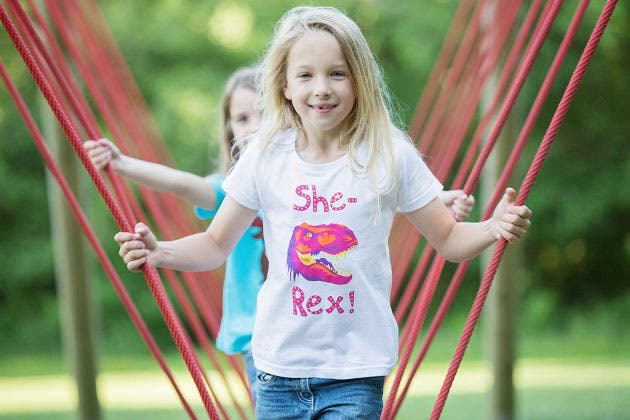 Clothing line features cute dinosaurs carrying flowers, female robots and a feisty girl robot. (Photo courtesy: climbingtreeskids.com)