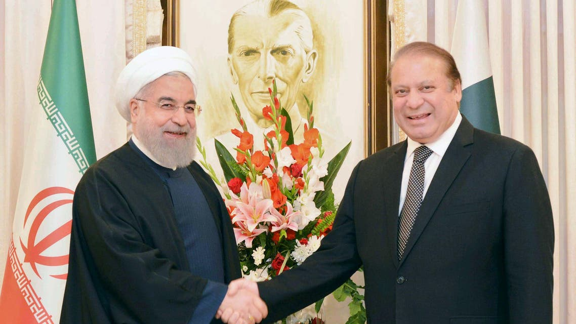 Pakistan's Prime Minister Nawaz Sharif (R) shakes hands with Iranian President Hassan Rouhani at the Prime Minister's house in Islamabad, Pakistan, in this March 25, 2016 handout photo. REUTERS/Press Information Department(PID)/Handout via Reuters ATTENTION EDITORS - THIS IMAGE HAS BEEN SUPPLIED BY A THIRD PARTY. REUTERS IS UNABLE TO INDEPENDENTLY VERIFY THE AUTHENTICITY, CONTENT, LOCATION OR DATE OF THIS IMAGE. FOR EDITORIAL USE ONLY. NOT FOR SALE FOR MARKETING OR ADVERTISING CAMPAIGNS. EDITORIAL USE ONLY. NO RESALES. NO ARCHIVE. THIS PICTURE WAS PROCESSED BY REUTERS TO ENHANCE QUALITY. AN UNPROCESSED VERSION HAS BEEN PROVIDED SEPARATELY.