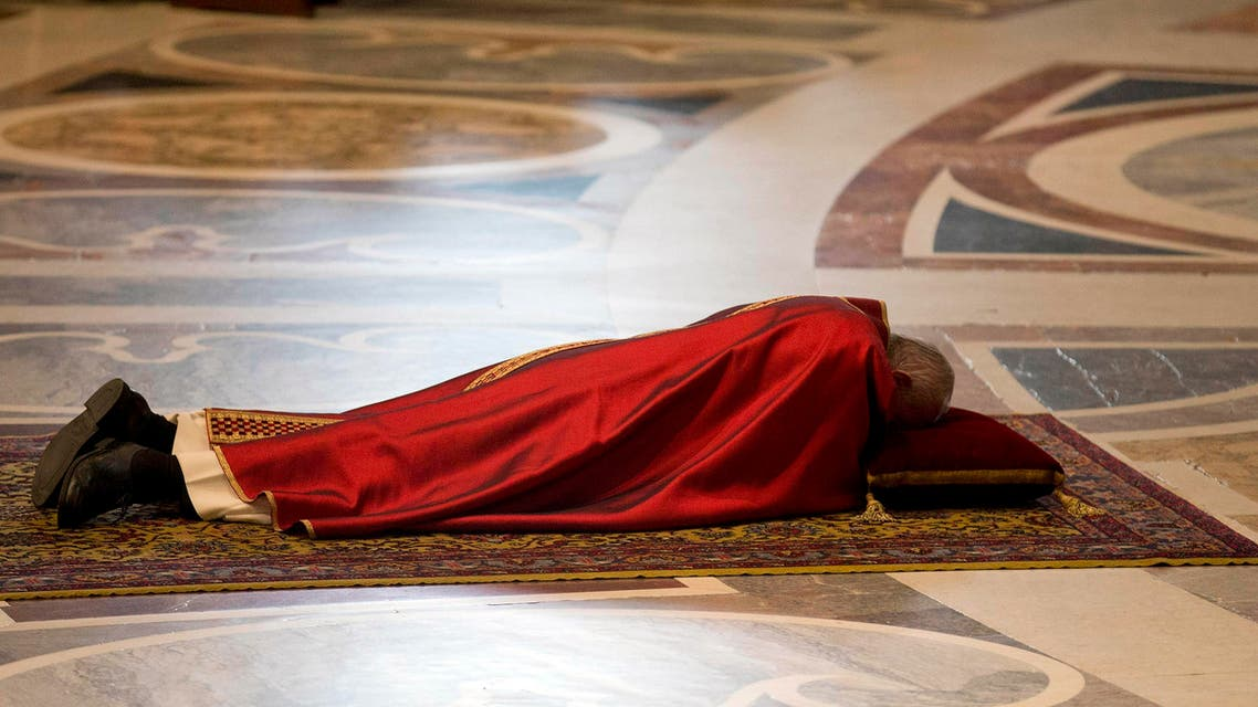 Pope Francis lies as he prays during the Celebration of the Lord's Passion in Saint Peter's Basilica at the Vatican. (Reuters)