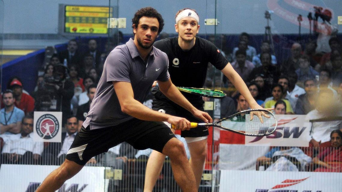 Egypt's Ramy Ashour, front, plays against England's James Willstrop during the finals of the World Squash Federation World Cup in Chennai, India, Saturday, March 12, 2011. Ashour won the match 3-0. (AP)