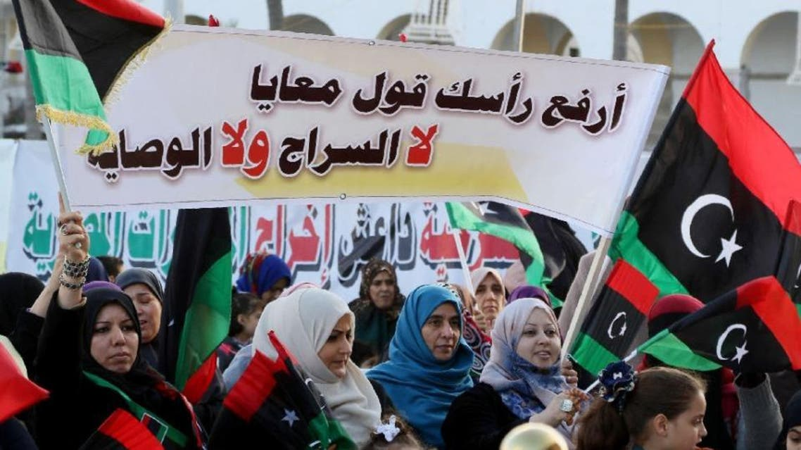 "Libyans hold a banner which reads, ""Lift your head and say no to Sarraj, no to his rule"" during a protest in Tripoli against the UN-backed unity government on March 25, 2016 (AFP)"