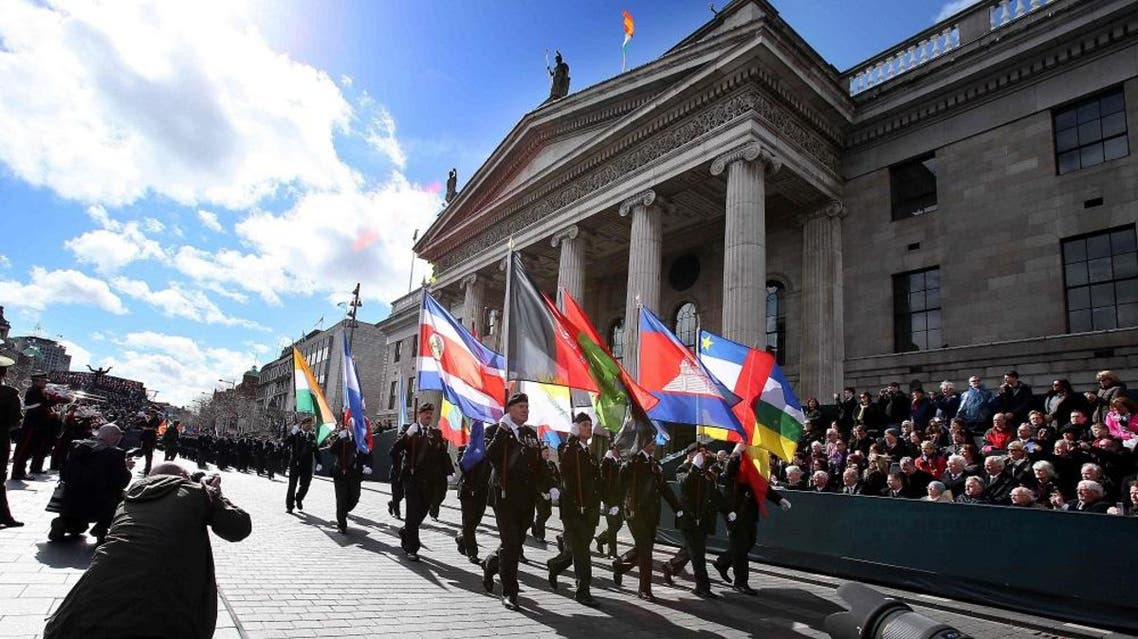 Members of the Irish army march past the General Post Office (GPO), the scene of the 1916 Easter Rising, in Dublin on March 27, 2016 during a programme of commemorative events to mark the 100th anniversary of the Rising (AFP)