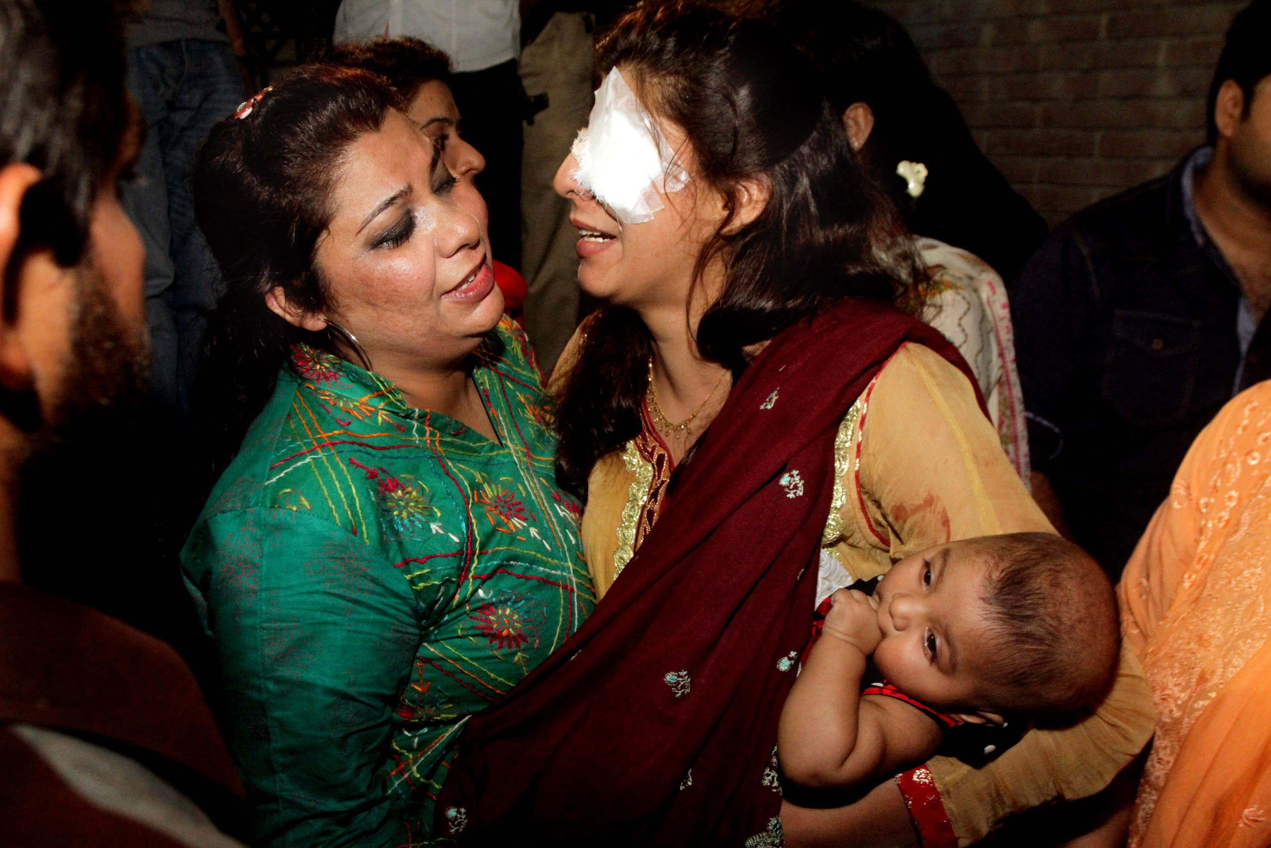 A woman injured in the bomb blast is comforted by a family member at a local hospital in Lahore, Pakistan, Sunday, March, 27, 2016.  (AP)