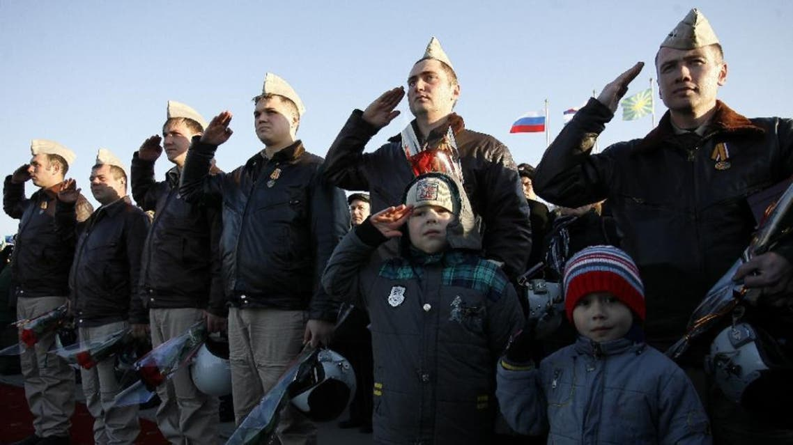 Russian air force pilots salute upon their arrival from Syria at an airbase in the southern Russia's Krasnodar region on March 16, 2016 (AFP)