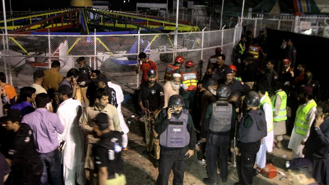 Pakistani police officers and rescue workers gather at the site of bomb explosion in a park in Lahore, Pakistan, Sunday, March, 27, 2016. A bomb blast in a park in the eastern Pakistani city of Lahore has killed tens of people and wounded scores, a health official said. (AP)