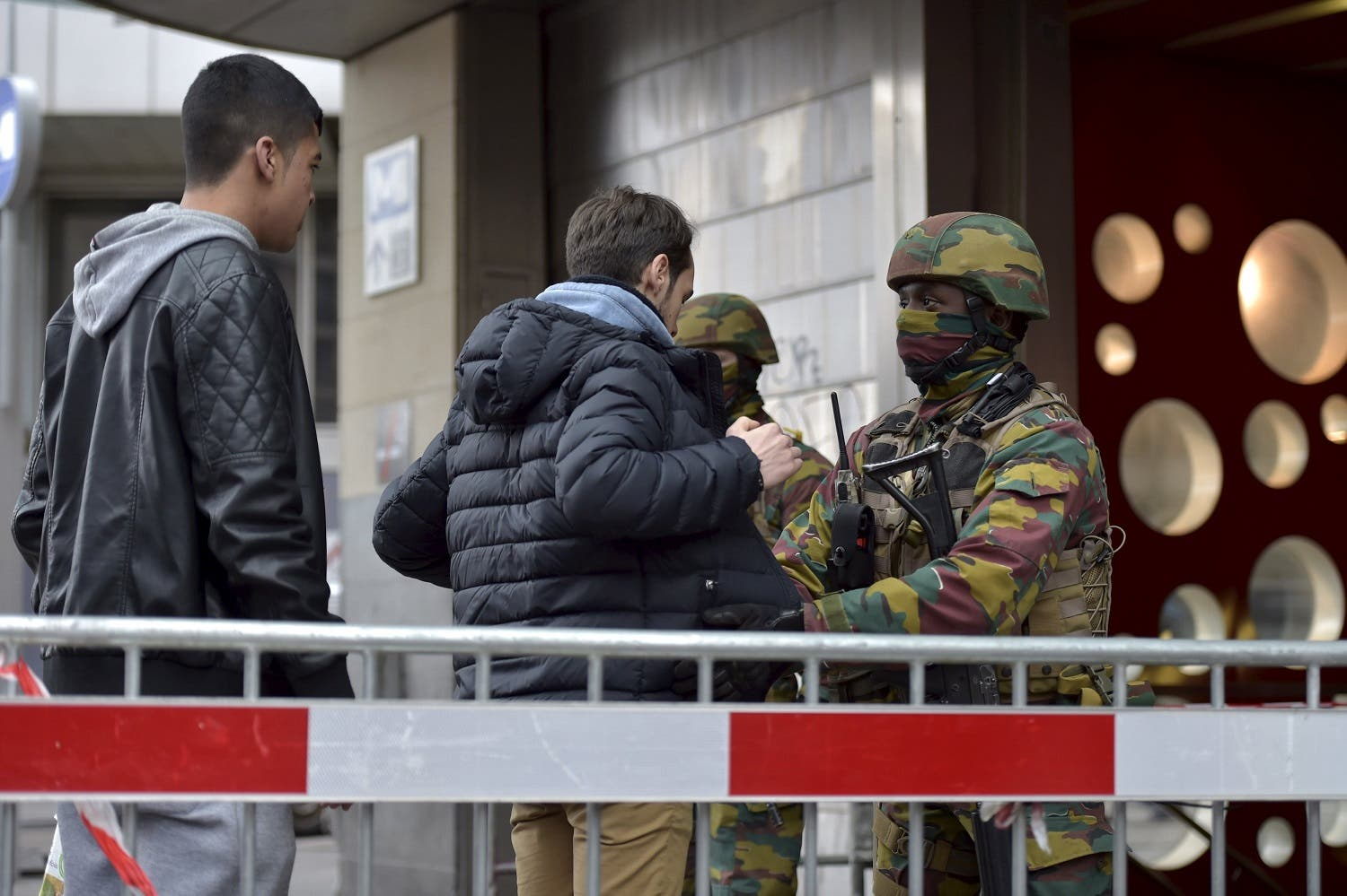 Belgian troops search people entering a subway station following Tuesday's bomb attacks in Brussels, Belgium, March 23, 2016. REUTERS