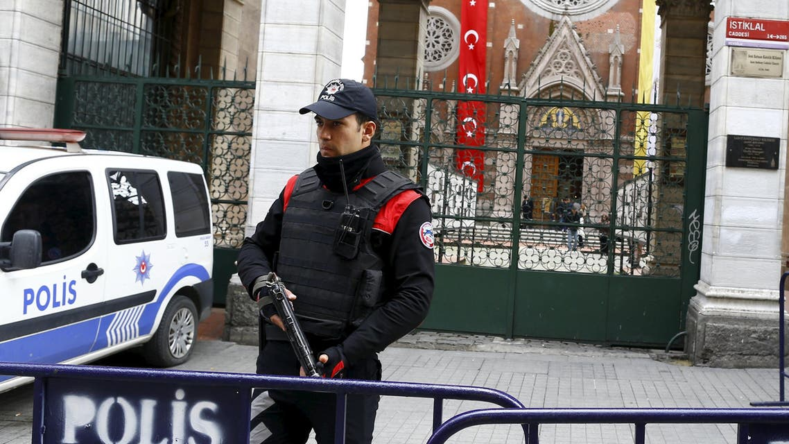 A Turkish police officer stands guard in front of St Antouan Church at Istiklal Street in Istanbul, Turkey March 27, 2016. (Reuters)