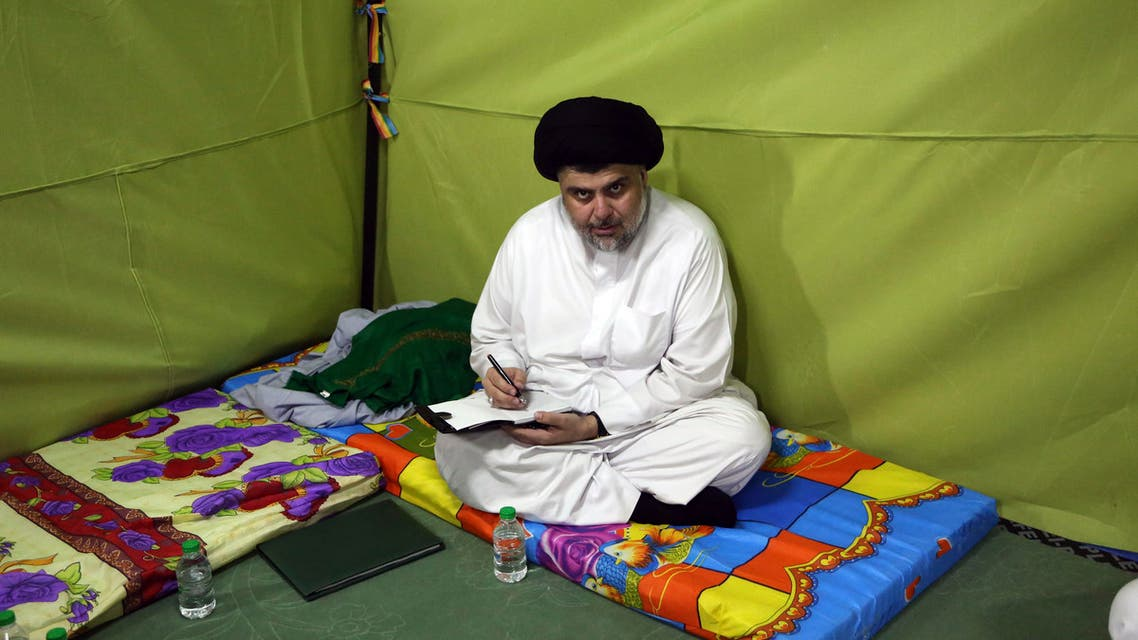 Shiite cleric Muqtada al-Sadr sits inside his tent during his sit-in inside the heavily guarded Green Zone, in Baghdad, Iraq, Sunday, March, 27, 2016. (AP)