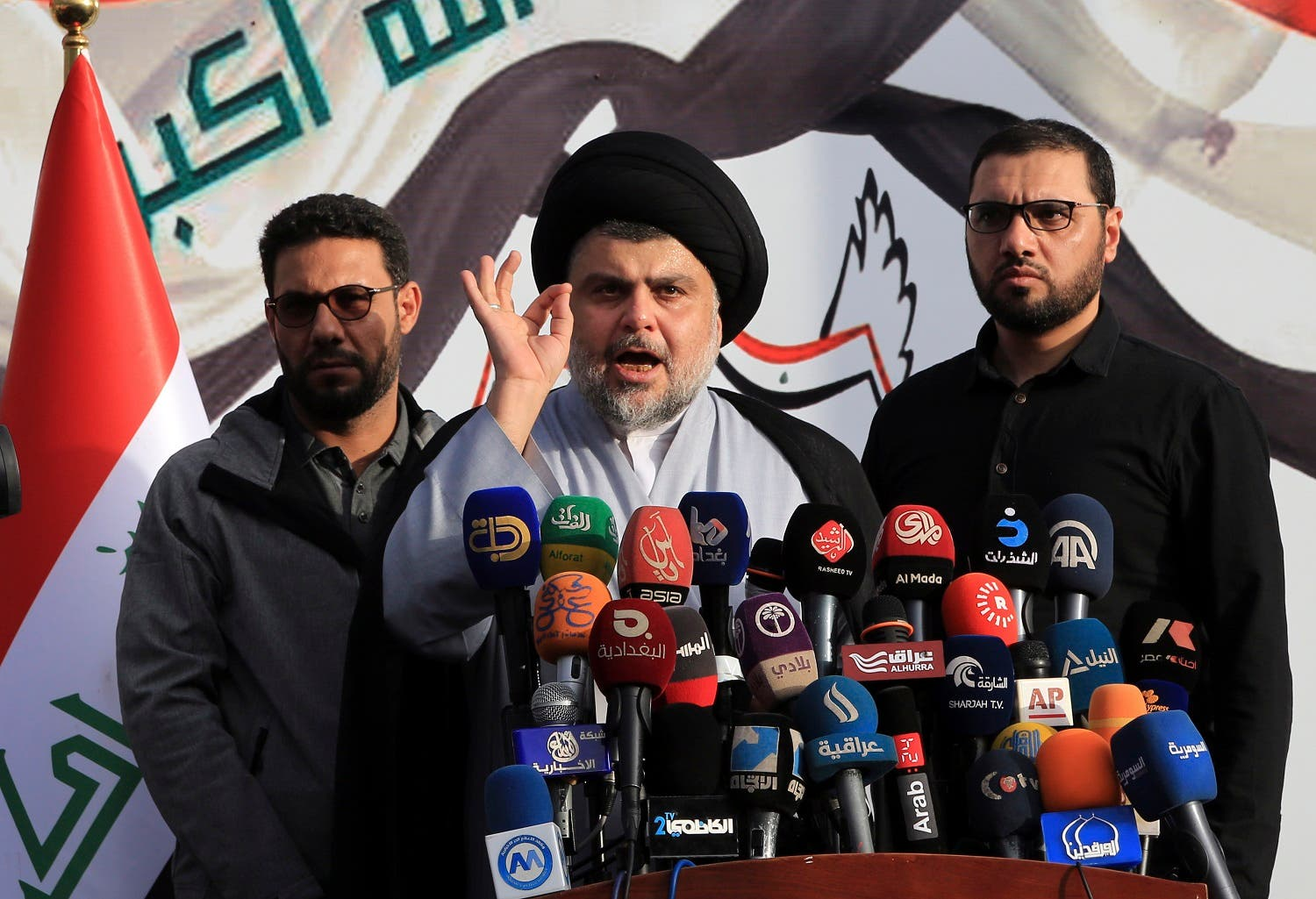 Shiite cleric Muqtada al-Sadr, center, gives a speech to his supporters before entering the highly fortified Green Zone, in Baghdad, Iraq, Sunday, March, 27, 2016. Al-Sadr brushed past security checkpoints to enter Baghdad's highly fortified Green Zone Sunday after weeks of protests in the Iraqi capital. (AP)